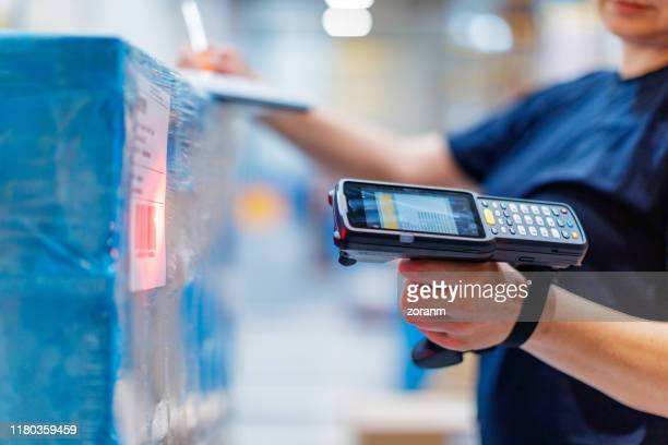 woman with barcode reader in warehouse - bar code stock pictures, royalty-free photos & images