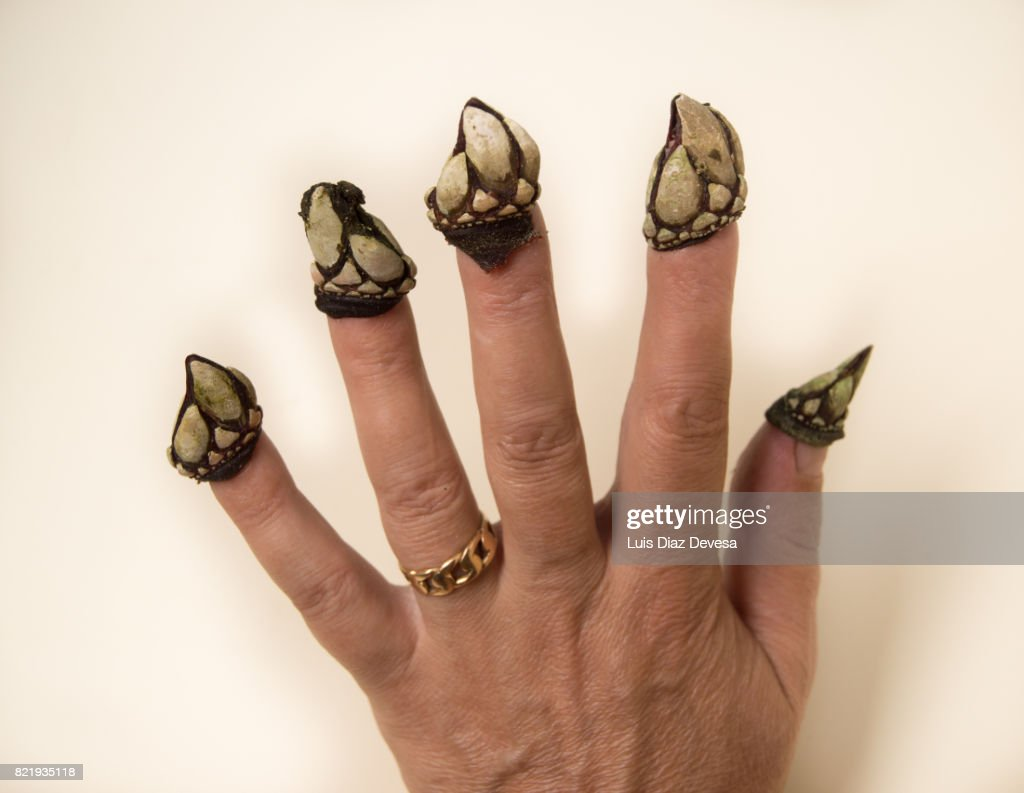Woman with barnacles on her nails : Stock Photo