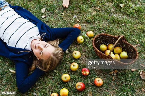 Woman with basket of apples