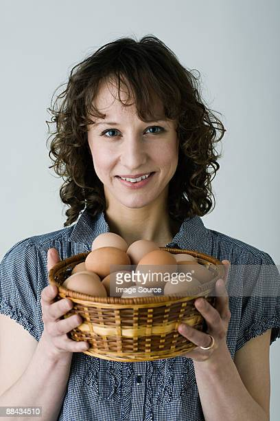 Woman with basket of eggs