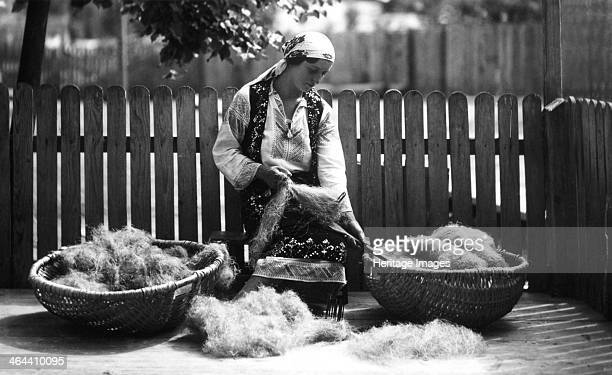 Woman with baskets of wool Bistrita Valley Moldavia northeast Romania c1920c1945 Depicting customs and traditional labour in the rural Carpathian...