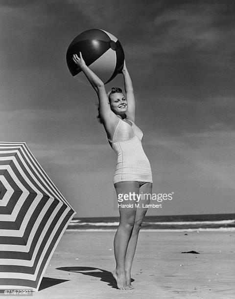 Woman With Beach Ball At Beach