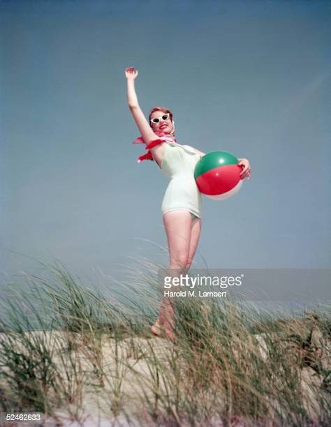 Woman With Beach Ball On Dune