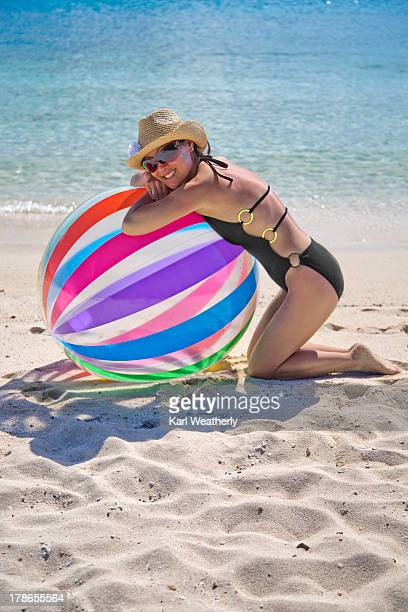 woman with beach ball - older woman bending over stock pictures, royalty-free photos & images
