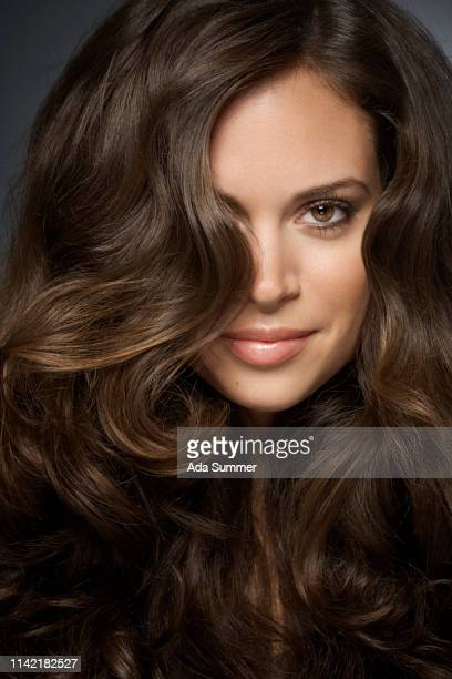 woman with beautiful curly hair - brown hair stock pictures, royalty-free photos & images