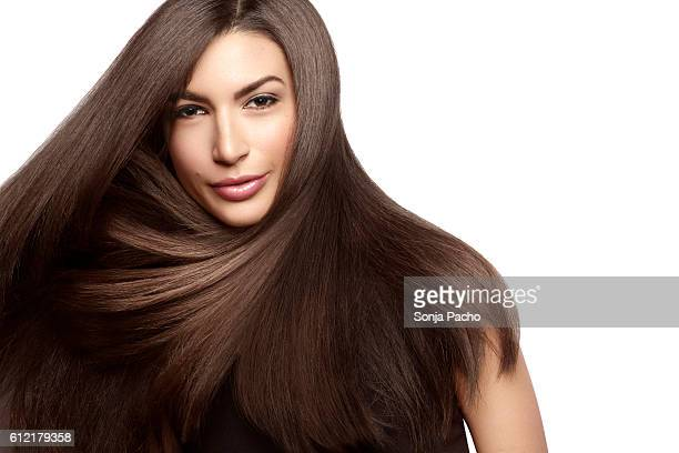 woman with beautiful hair - steil haar stockfoto's en -beelden