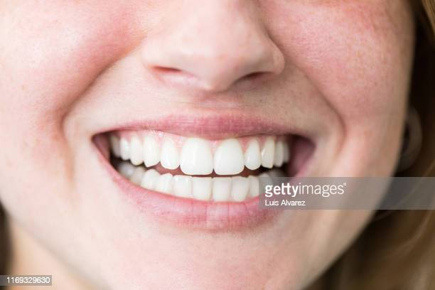 woman with beautiful toothy smile - 歯 ストックフォトと画像