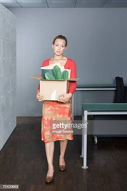 Woman with belongings in a box