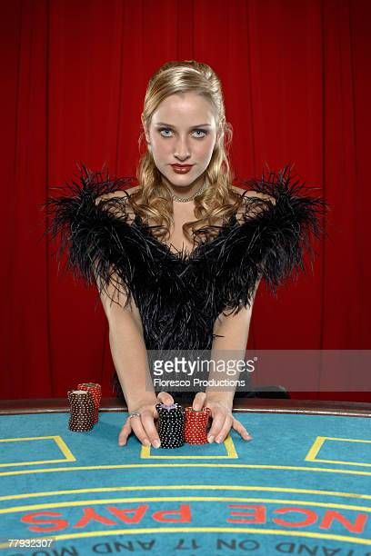 Woman with betting chips on casino table