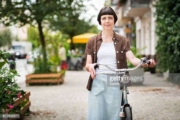 woman with bicycle in berlin, germany - prenzlauer berg stock photos and pictures