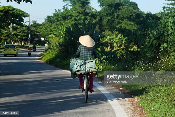 Woman with bicycle on country road