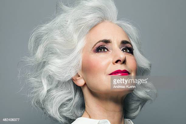 woman with big grey hair looking up, portrait. - white hair stock pictures, royalty-free photos & images