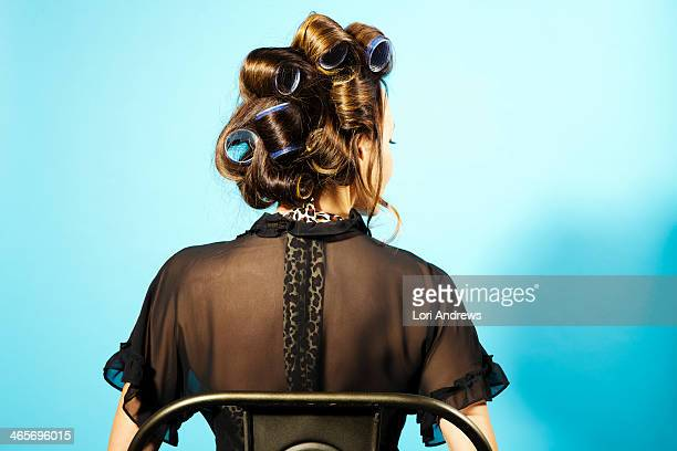 Woman with big hair curlers