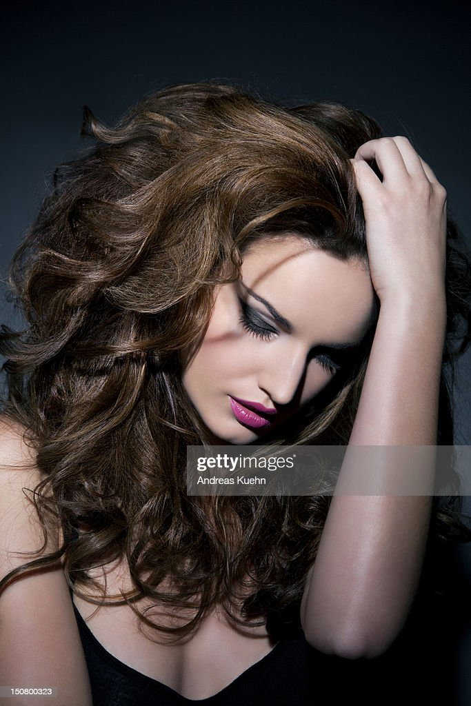 Woman with big hair looking down, portrait. : Foto de stock