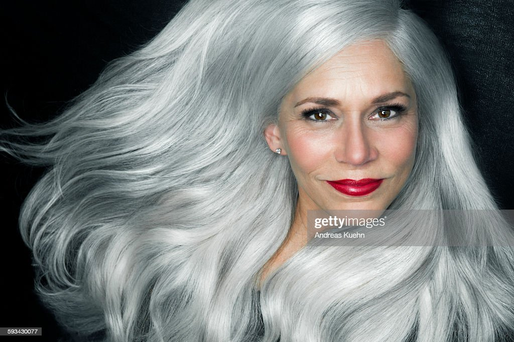 Woman with big, wavy, silver gray hair, portrait. : Stock Photo