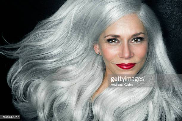 Woman with big, wavy, silver gray hair, portrait.