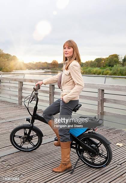Woman with bike on wooden walkway