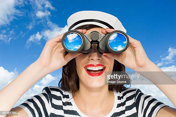 woman with binoculars - sailor hat stock pictures, royalty-free photos & images
