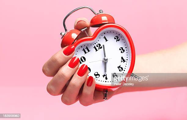 woman with biological clock ticking - time stock pictures, royalty-free photos & images