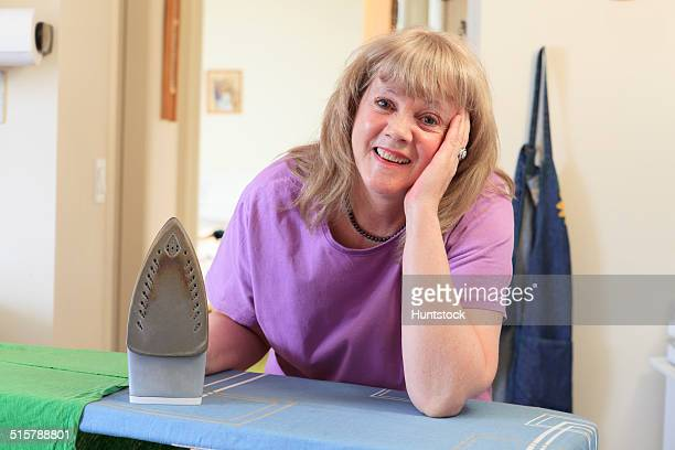 Woman with Bipolar disorder ironing her dress for work