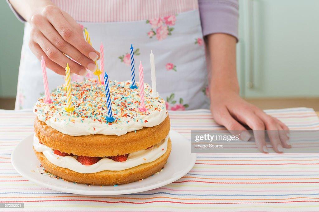 Woman With Birthday Cake Stock Photo