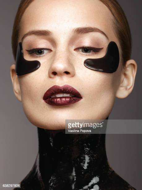 Woman with black eye patches