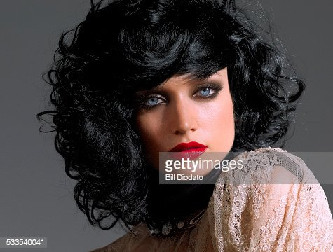 Woman With Black Hair And Red Lip High Res Stock Photo