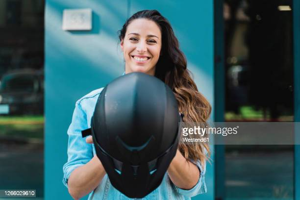 woman with black motorcycle helmet - sports helmet stock pictures, royalty-free photos & images