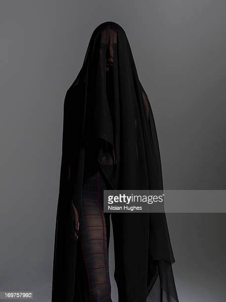 Woman with black silk covering her over her head