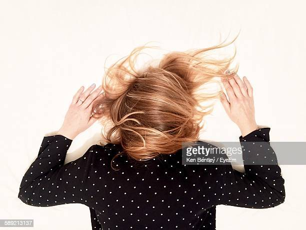 Woman With Blond Hair Lying On White Background
