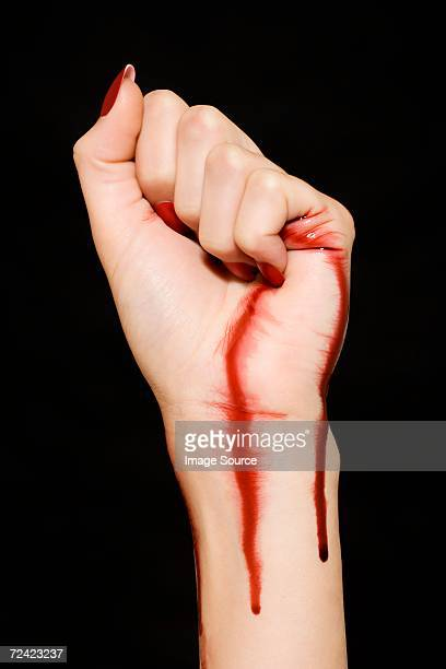 woman with blood on her hand and wrist - bloody hand stock photos and pictures
