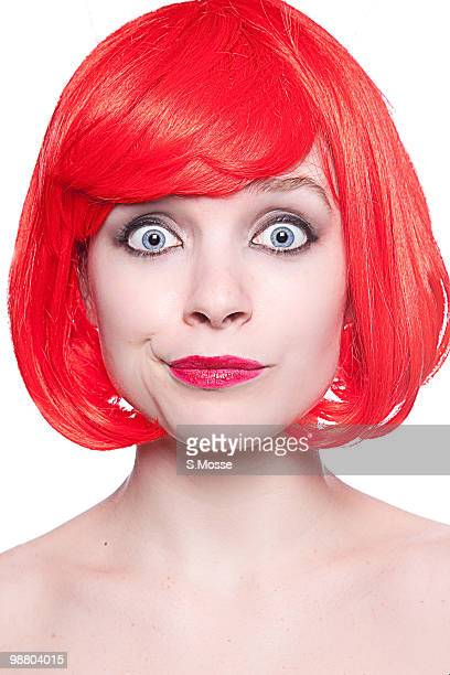 Woman with blue eyes and red hair close-up