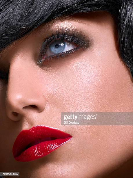 woman with blue eyes and red lips