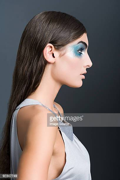 Woman with blue glitter eye makeup