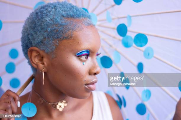 a woman with blue hair - dyed hair stock pictures, royalty-free photos & images