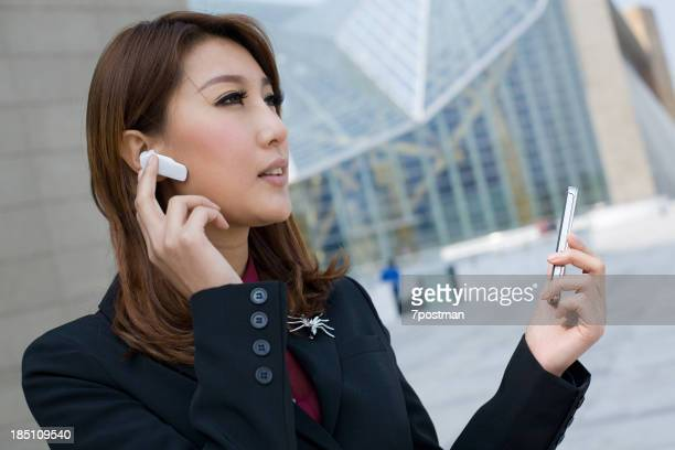 Woman with bluetooth and palmtop