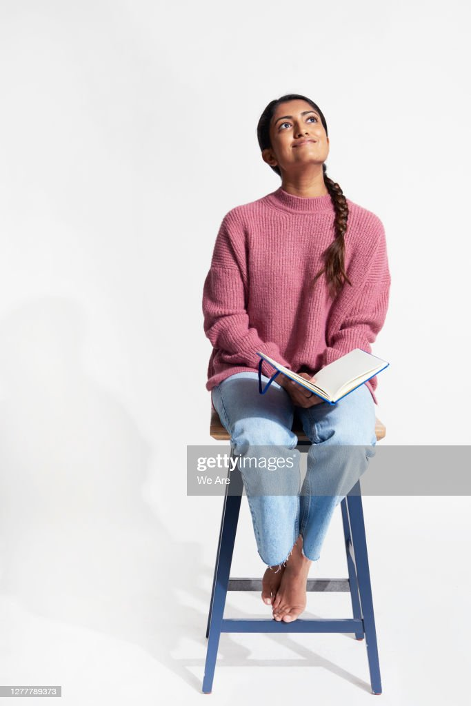 Woman with book smiling : Stock Photo
