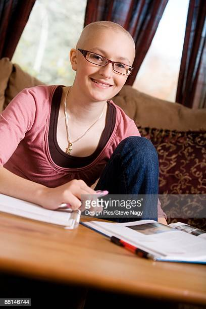 woman with books - bald girl stock photos and pictures