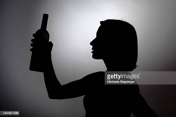 Woman with bottle of wine, silhouette