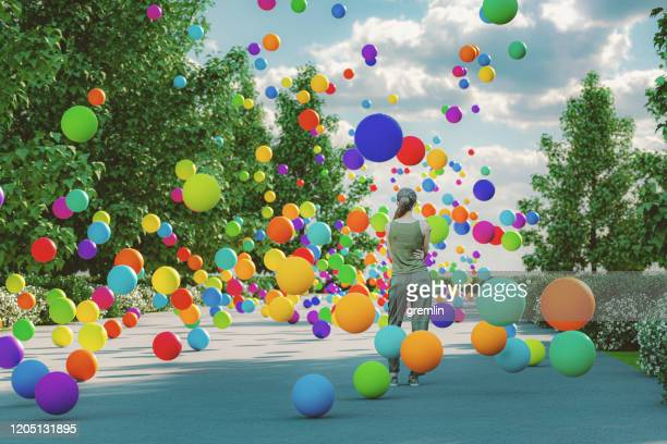 woman with bouncing spheres - ball stock pictures, royalty-free photos & images