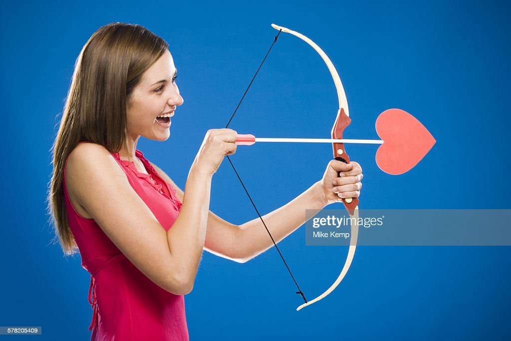 Woman with bow and arrow with heart : ストックフォト