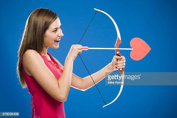 Woman with bow and arrow with heart