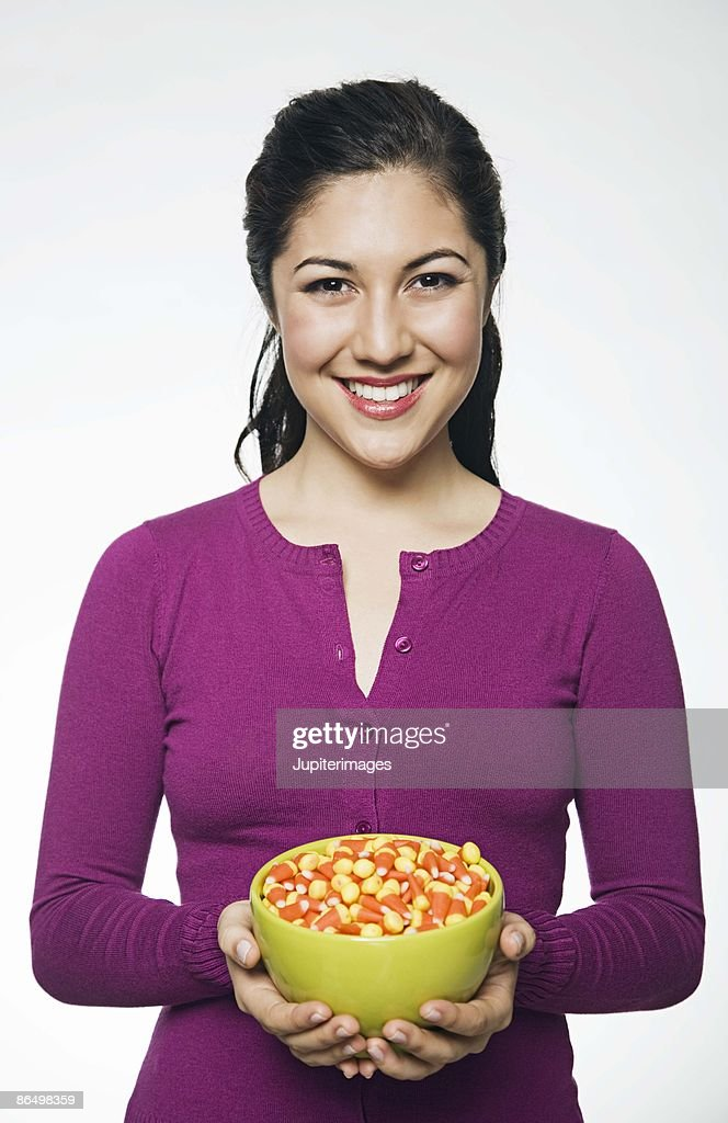 Woman with bowl of candy corn : Stock Photo