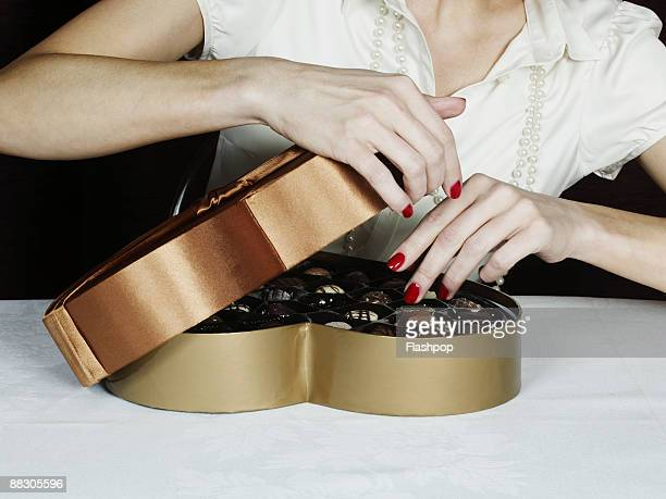 Woman with box of chocolates