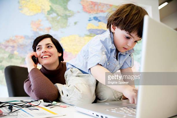 woman with boy in office