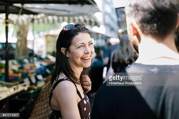 Woman with Boyfriend shopping at Farmer Market