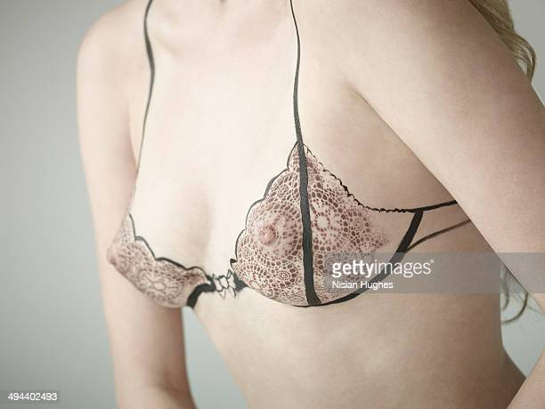 Woman with bra illustration over breasts