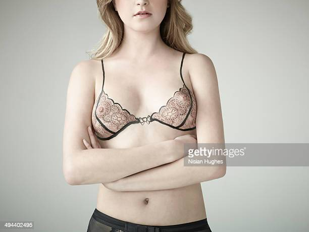woman with bra illustration over breasts - dressed undressed women stock pictures, royalty-free photos & images