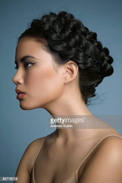 Woman with braided hair, profile.