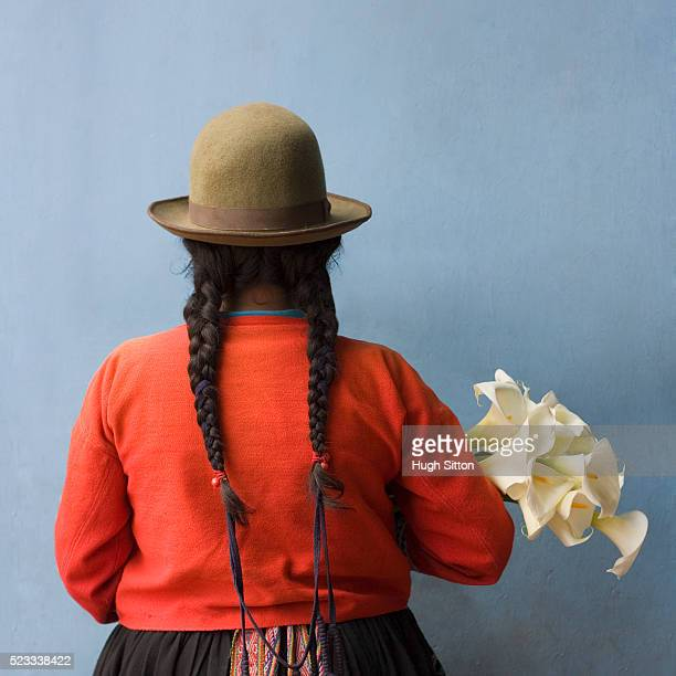 woman with braids holding flowers - hugh sitton stock-fotos und bilder